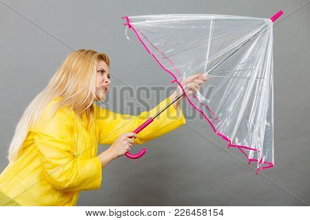 Rainy Autumn Day Accessories Ideas Concept. Woman Having Serious Face Expression Holding Opening Cle
