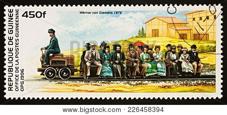 Moscow, Russia - February 13, 2018: A Stamp Printed In Guinea, Shows Electric Railway Of Siemens & H