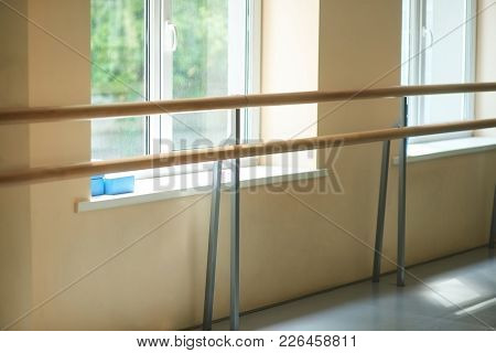 Ballet Barre In Dance Hall. Interior Of Dance Ballet Class. Barre And Windows Of Ballet Hall. Empty