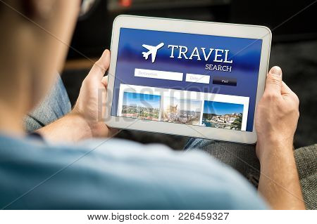 Man Searching Cheap Flights, Hotel Or Holiday Package On Internet By Using Online Travel Search Appl