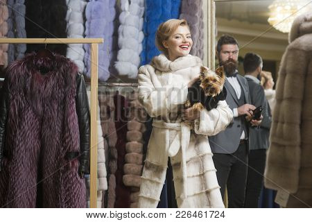 Purchase, Business, Moneybags. Purchase, Woman With Yorkshire Terrier Pet Dog And Man Buy Fur Coat.