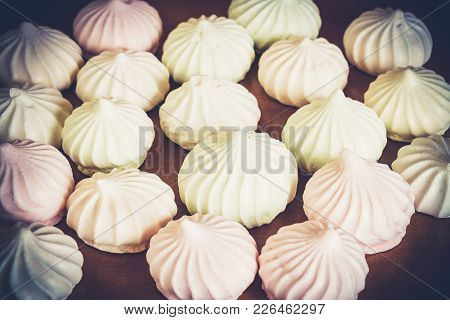 Many Sweet Spiral White Meringues. Selective Focus.