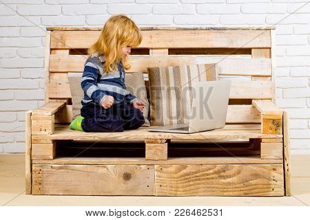Small Boy Blogging On Bench, Online Buy. Child With Laptop And Mobile Phone, Education. Social Netwo
