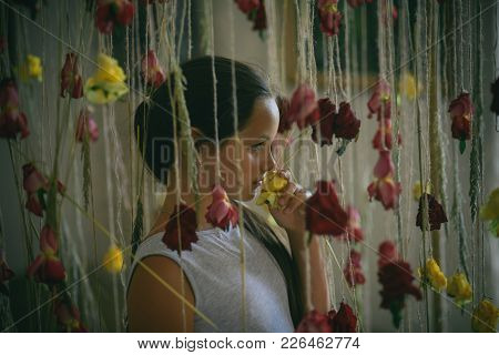 Child With Roses In Florist Shop, Floristry. Little Girl With Flower Decor In Floral Shop. Valentine