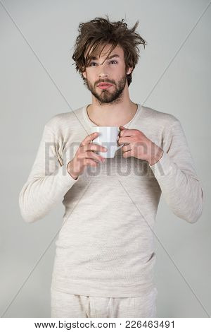Cold And Flu, Single. Man With Disheveled Hair Drink Mulled Wine. Sleepy Guy With Tea Cup On Grey Ba