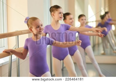 Female Ballet Dancers Having Rehearsal. Cute Little Ballerinas Performing Dance Exercises In Ballet