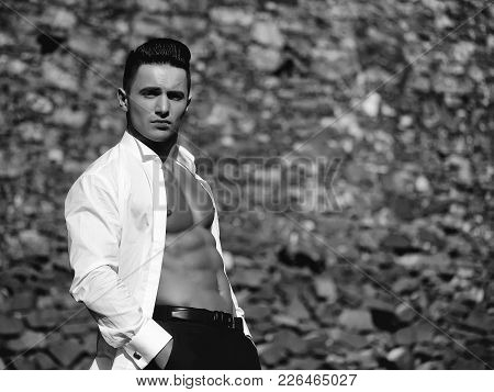 Man Bare-chested Young Handsome Sensual Model In White Shirt Gaped Open Poses With Hands In Black Tr