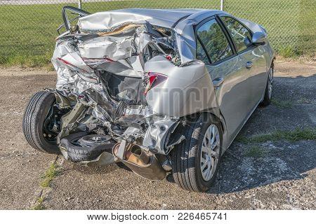 Horizontal Shot Of A Car Demolished By A Wreck At An Angle