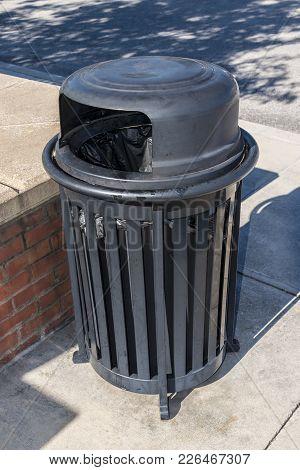 Vertical Close-up Shot Of An Outdoor Trash Receptable.