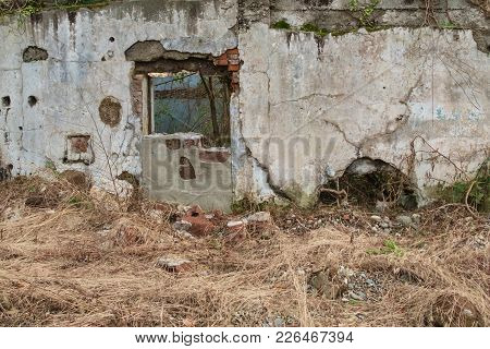 Old Shabby Cracked Wall With Door Section