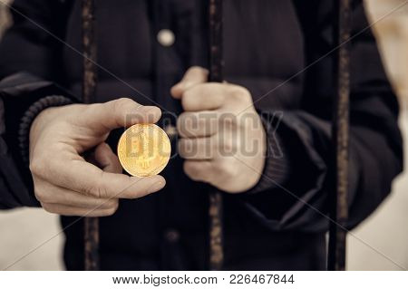 Imprisoned Hacker Holds Coin Bitcoin And Prison Lattice. Concept Arrest, Fraud And Deception With Cr
