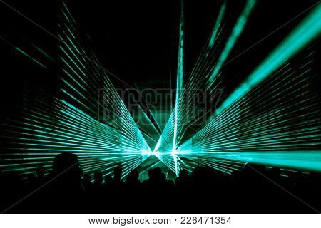 Turquoise Laser Show Nightlife Club Stage And Party People Crowd. Luxury Entertainment With Audience