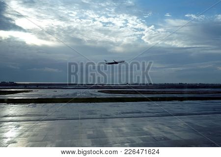 The Plane Takes Off Early In The Morning From The Aerodrome Runway Against The Backdrop Of The Dawn