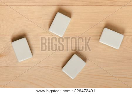 Empty White Tiles For Mahjong Against A Light Brown Tree