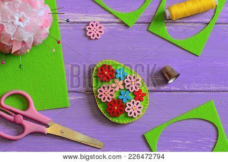 Felt Easter Egg Decor. Felt Easter Egg Decor With Wooden Flower Buttons. Felt Scrap, Scissors, Thimb