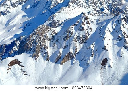 A Snow Covered French Alps Rocky Mountainside