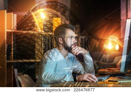 Working Man. Calm Clever Experienced Programmer Looking Attentively At The Screen Of A Modern Conven