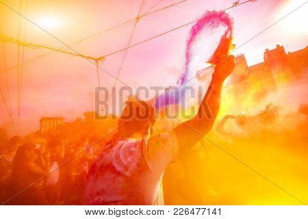 A Guy Standing With His Back Throws A Blue Paint Bag Up On Holi Celebration 9 September 2017 Moldova