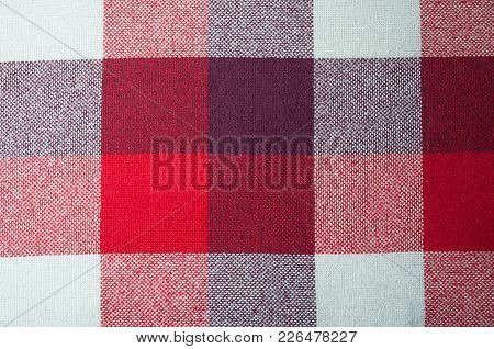 Textured Fabric With A Pattern Of Squares Of Shades Of Red, Purple And White
