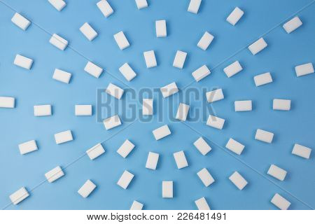 White Sugar Cubes On Blue Background. Top View