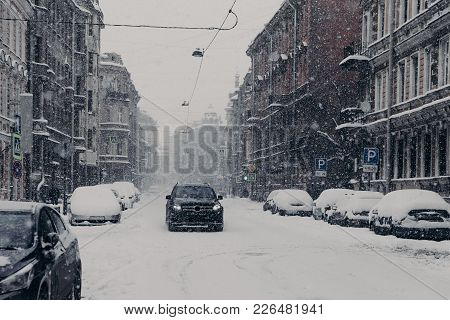 Beautiful View Of Wonderful Snowy City With Automobiles Covered With Snow. Urban Sreet. Frosty Weath