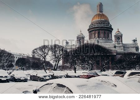 Rear View Of St Isaac`s Cathedral During Winter Weather, Covered With Snow. Famous Builduing Of Sain