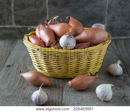 Garlic And Onion In The Basket On The Table