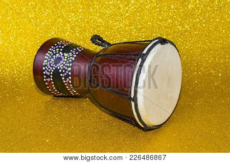 Darbuka On A Yellow Background Two Pieces.