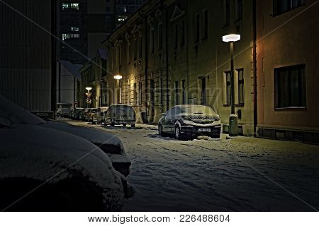 Chomutov, Czech Republic - January 22, 2018: Cars Between Houses In Lidicka Street Under Snow In Win