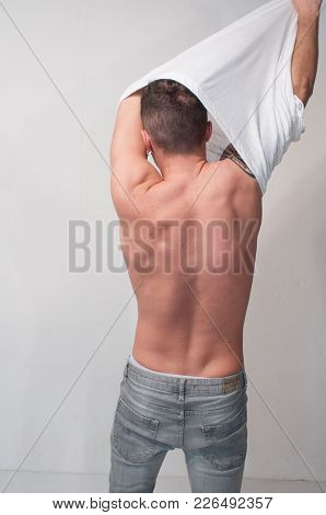 Sexy Young Man Or Guy With Bare Muscular Chest In Shirt On White Wall Background, Back While You Tak