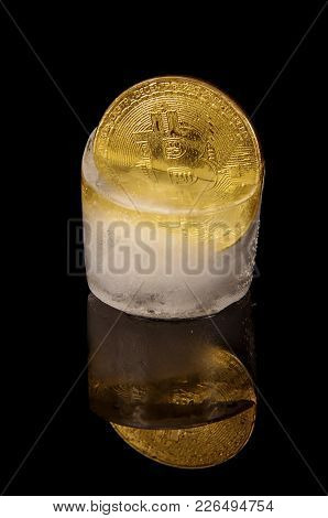 Golden Bitcoin Frozen In The Ice As A Concept Of Restrictions