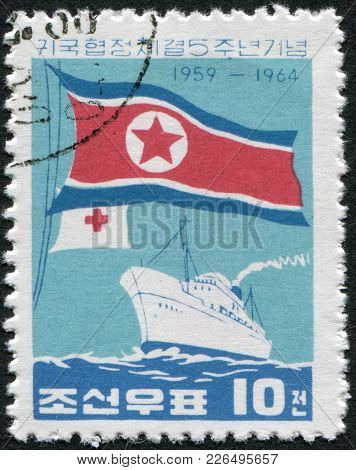 North Korea - Circa 1964: A Stamp Printed In North Korea, Is Dedicated To The 5th Anniversary Of The