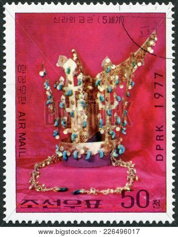 North Korea - Circa 1977: A Stamp Printed In North Korea, Shows A Cultural Property, Gold Jewelry Er