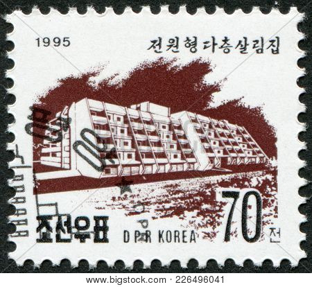 North Korea - Circa 1995: A Stamp Printed In North Korea Shows A Block Of Flats On Kwangbok Street I