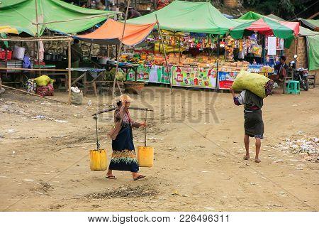 Mandalay, Myanmar - December 30: Unidentified People Walk At Ayeyarwady River Port On December 30, 2