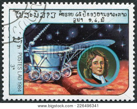 Laos-circa 1984: A Stamp Printed In The Laos, Depicts The Spacecraft Lunokhod-2 And A Portrait Of Is