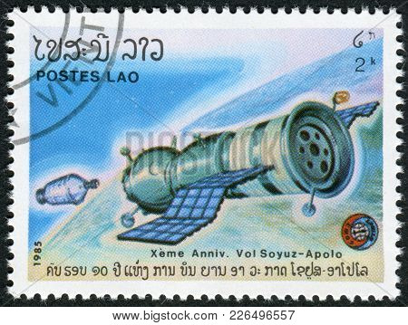 Laos-circa 1985: A Stamp Printed In The Laos, Depicts The Spacecraft Soyuz Approaching Apollo, Circa