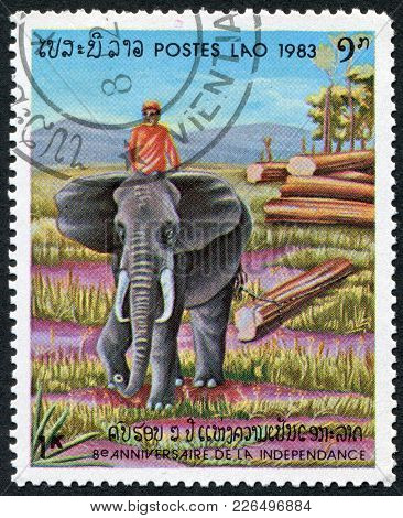 Laos-circa 1983: A Stamp Printed In The Laos, Is Dedicated To The 8 Th Anniversary Of Independence,