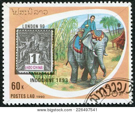 Laos-circa 1990: A Stamp Printed In The Laos, Mail Delivery On Elephants In Indochina, Circa 1990