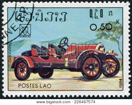 Laos-circa 1984: A Stamp Printed In The Laos, Is Devoted To 19th Upu Congress, Hamburg. Classic Spor