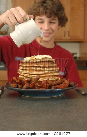 Boy With Enormous Pancake Breakfast