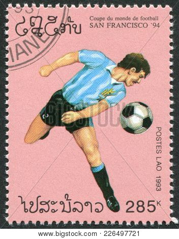 Laos-circa 1993: A Stamp Printed In The Laos, Is Dedicated To World Cup Soccer Championships, Usa, C