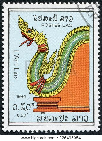 Laos-circa 1984: A Stamp Printed In The Laos, Depicts Dragon (hand Rail), Circa 1984