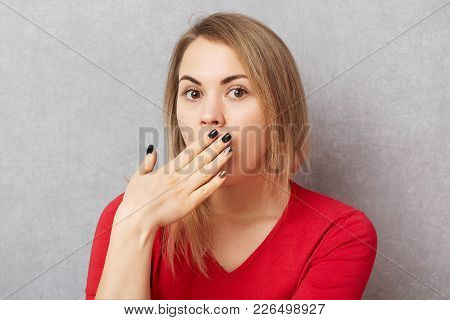 Surprised Shocked Female Gossips With Her Best Friend, Covers Mouth With Hands As Hears Unexpected I