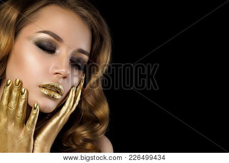 Beauty Portrait Of Young Woman With Golden Makeup. Perfect Skin And Fashion Makeup With Gold Accents