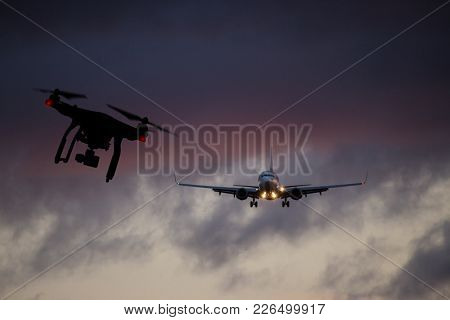Drone flying near commercial airplane, danger of collision.