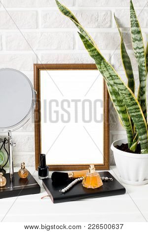 A4 Poster Beauty Fashion Mock-up In Wooden Frame On White Wooden Table And White Painted Brick Wall
