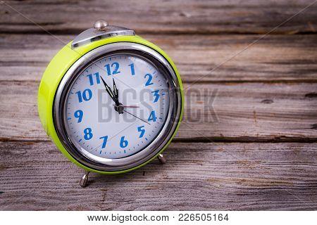 Alarm Clock With Four Minutes To Twelve O'clock