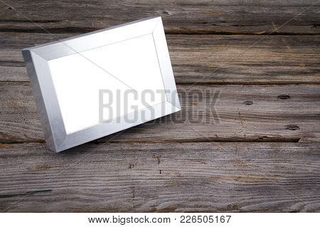 Blank Silver Picture Frame On Wooden Rustic Background Table