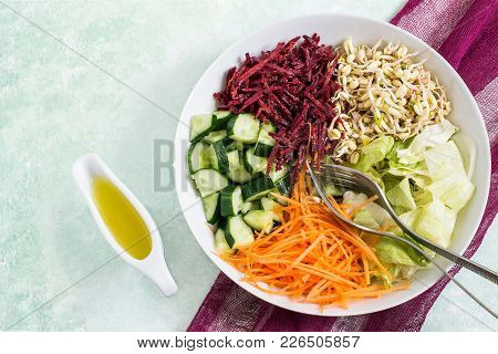 Vegetarian Lunch Bowl With Sprouted Beans Mung, Carrot, Beet, Cucumber, Iceberg Lettuce On Light Gre